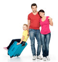 Parent with daughter and suitcase  at studio Stock Images