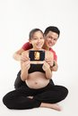 Parent holding d scan happy husband and wife their baby s Stock Photos