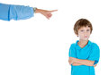 Parent pointing at a disobedient child closeup portrait of in blue shirt scolding to go to room grounded for misbehaving while kid Royalty Free Stock Image
