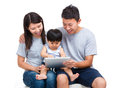 Parent using tablet with thier baby son Royalty Free Stock Photo