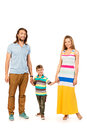 Parenthood full length portrait of a happy family father mother and son isolated over white Stock Photo