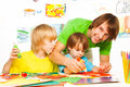 Parenting is fun father helping little boys to glue paper as they crafting together Stock Image
