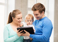 Parents and adorable baby with tablet pc happy Stock Photo