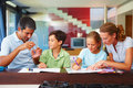 Parents assisting their children in their homework Stock Image