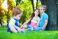 Parents with baby in a greenl summer park Stock Photography