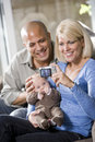 Parents with baby at home, mom holding camera Stock Images