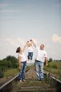 Parents with baby on railroad happy Stock Image
