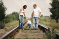 Parents with baby on railroad happy Stock Photos