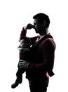 Parents with baby silhouette in silhouettes on white background Royalty Free Stock Photo