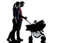 Parents with baby silhouette in silhouettes on white background Stock Photo