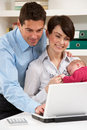 Parents With  Baby Working From Home Royalty Free Stock Image