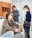 Parents berating teenager son in home Stock Photo