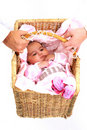 Parents carrying newborn baby in basket Royalty Free Stock Images