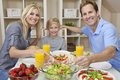 Parents Child Family Healthy Food At Dining Table Stock Images
