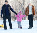 Parents with child in a winter park family walking Royalty Free Stock Image