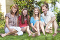 Parents Children Family Healthy Sitting In Garden Royalty Free Stock Image
