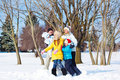 Parents and children  playing in snow Stock Photo