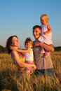 Parents with children on wheaten field Royalty Free Stock Photo