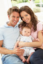 Parents Cuddling Newborn Baby Boy At Home Stock Images
