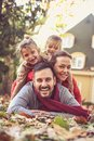 Parents with daughters make people pyramid. Royalty Free Stock Photo