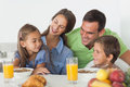 Parents having breakfast with their children in the kitchen Royalty Free Stock Photo