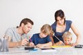 Parents helping their children with homework Stock Image
