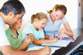 Parents helping their children with their homework Royalty Free Stock Photo
