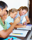 Parents helping their children with their homework Royalty Free Stock Photography