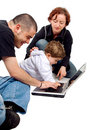 Parents and kid on a laptop Royalty Free Stock Photo