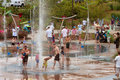 Parents and kids get soaked in water park fountains atlanta ga usa june playing the at the old fourth ward atlanta Stock Photos