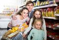 Parents with kids and purchases Royalty Free Stock Photo
