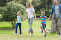 Parents and kids walking in park full length of the Stock Photography
