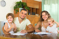 Parents and little daughters with documents Royalty Free Stock Photo
