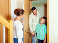 Parents meeting with abuse of teenage son a in the doorway Stock Photo