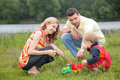 Parents play with child outdoor Royalty Free Stock Photography
