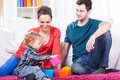 Parents playing with child young their in living room Royalty Free Stock Image