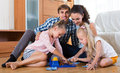 Parents playing lotto with kids Royalty Free Stock Photo