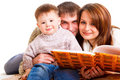 Parents reading to their kid Royalty Free Stock Photo
