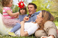 Parents Sitting With Children In Field Royalty Free Stock Photo