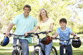Parents And Son On Cycle Ride In Park Royalty Free Stock Photo
