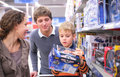 Parents with son with toy in shop Royalty Free Stock Photo