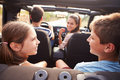 Parents Taking Children On Trip In Open Top Car Royalty Free Stock Photo