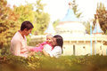 Parents with their baby girl in the park playing Royalty Free Stock Image