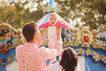 Parents with their baby girl in the park playing Royalty Free Stock Photos