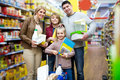 Parents with two kids holding purchases in store Royalty Free Stock Photo