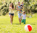 Parents with two kids outdoors Royalty Free Stock Photo