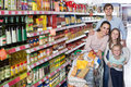 Parents with two kids and purchases in shopping cart Royalty Free Stock Photo