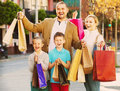 Parents with two teenagers going for shopping outdoors Royalty Free Stock Photo