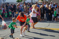 Parents volunteers try to get young kids to run lil kernel race popcorn festival valparaiso some need more help encouragement then Royalty Free Stock Images