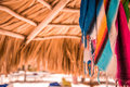 Pareo under sunshade bright multicolored from palm leaves toned Stock Image